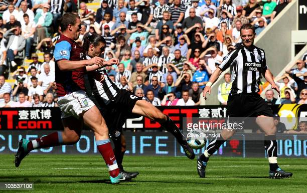 Andy Carroll of Newcastle United scores his teams fourth goal during the Barclays Premier League match between Newcastle United and Aston Villa at St...