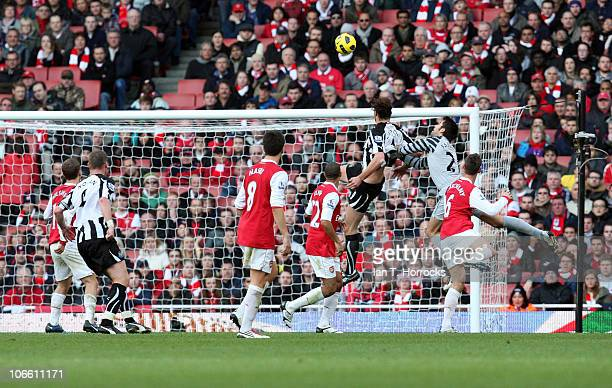 Andy Carroll of Newcastle United scores his team's opening goal during the Barclays Premier League match between Arsenal and Newcastle United at...