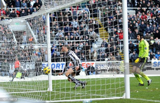 Andy Carroll of Newcastle United scores the opening goal during the Barclays Premier League game between Newcastle United and Chelsea on November 28...