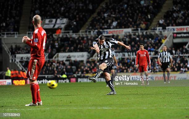 Andy Carroll of Newcastle United scores the third Newcastle goal during the Barclays Premier League game between Newcastle United and Liverpool at St...