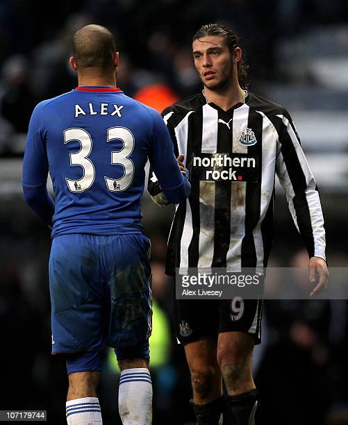 Andy Carroll of Newcastle United shakes hands with Alex of Chelsea at the end of the Barclays Premier League match between Newcastle United and...