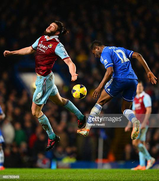 Andy Carroll of West Ham and John Obi Mikel of Chelsea go up for header during the Barclays Premier League match between Chelsea and West Ham United...