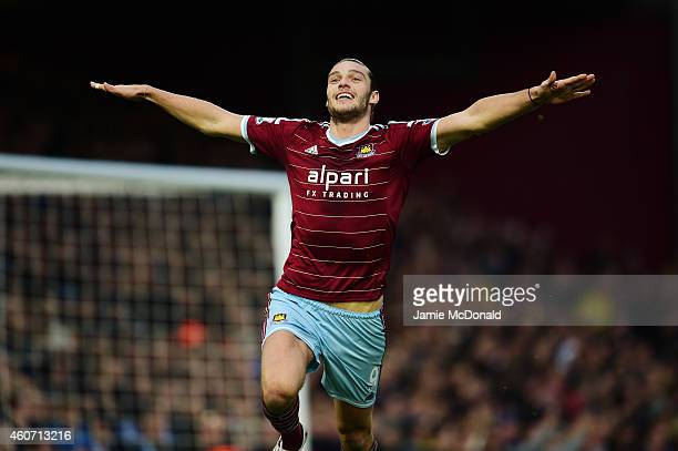 Andy Carroll of West Ham celebrates scoring the first goal during the Barclays Premier League match between West Ham United and Leicester City at...