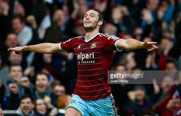Andy Carroll of West Ham celebrates scoring their first goal during the Barclays Premier League match between West Ham United and Swansea City at...