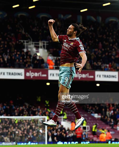 Andy Carroll of West Ham celebrates scoring their second goal during the Barclays Premier League match between West Ham United and Swansea City at...