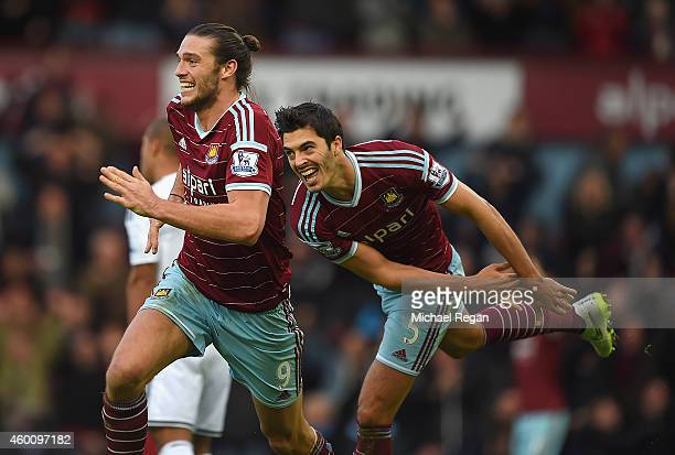 Andy Carroll of West Ham celebrates scoring their second goal with James Tomkins of West Ham during the Barclays Premier League match between West...