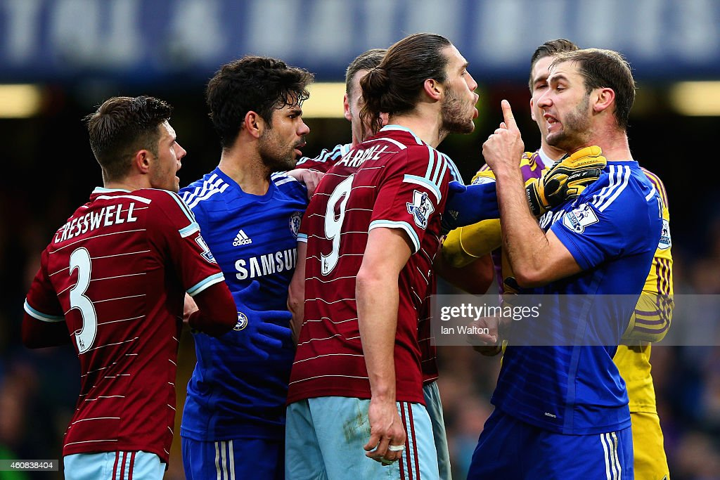 Andy Carroll of West Ham clashes with Branislav Ivanovic of Chelsea during the Barclays Premier League match between Chelsea and West Ham United at Stamford Bridge on December 26, 2014 in London, England.