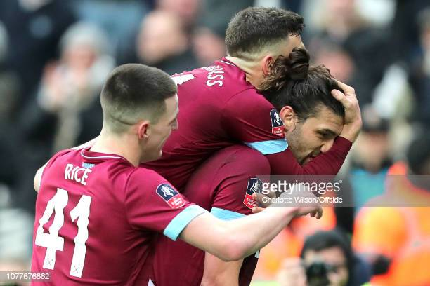 Andy Carroll of West Ham is mobbed by teammates Robert Snodgrass and Declan Rice as they celebrate his goal during the FA Cup Third Round match...