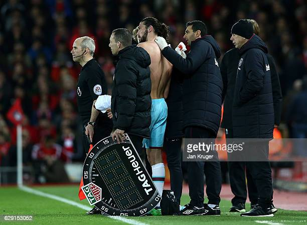 Andy Carroll of West Ham receives treatment on the sideline for a cut during the Premier League match between Liverpool and West Ham United at...