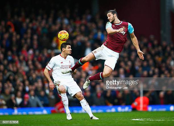 Andy Carroll of West Ham United and Dejan Lovren of Liverpool compete for the ball during the Barclays Premier League match between West Ham United...