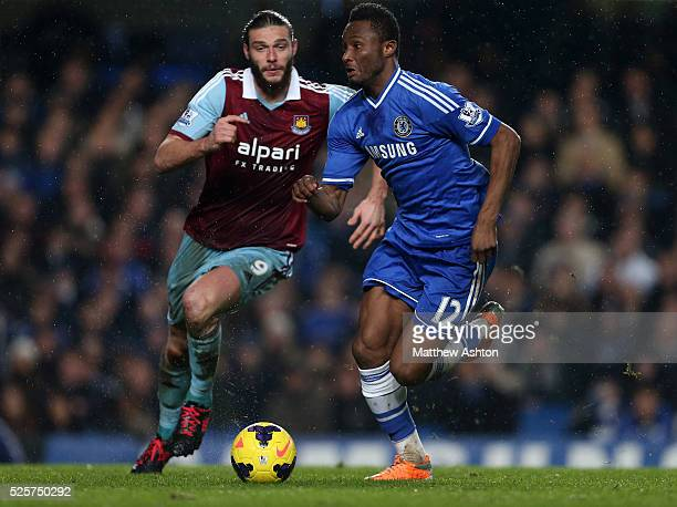 Andy Carroll of West Ham United and Mikel John Obi of Chelsea