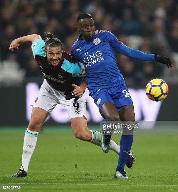 Andy Carroll of West Ham United and Wilfred Ndidi of Leicester City battle for the ball during the Premier League match between West Ham United and...