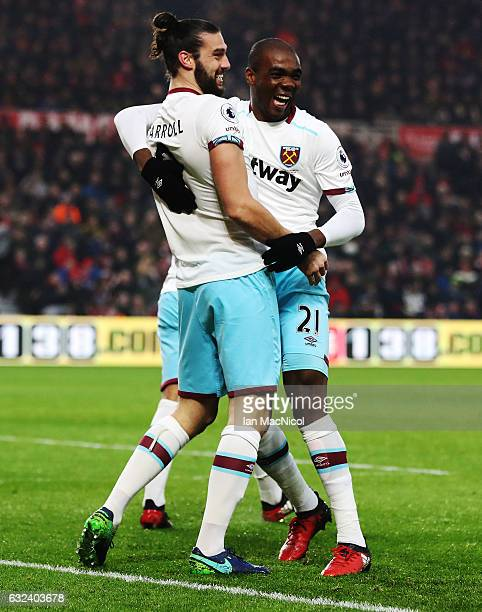 Andy Carroll of West Ham United celebrates after scoring his first goal with Angelo Ogbonna Obinze during the Premier League match between...