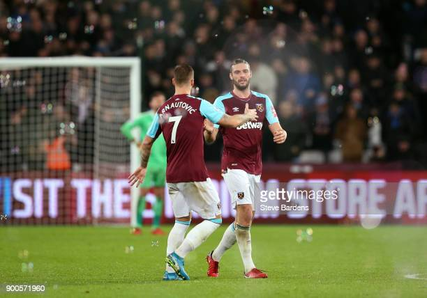 Andy Carroll of West Ham United celebrates after scoring his sides first goal with Marko Arnautovic of West Ham United during the Premier League...