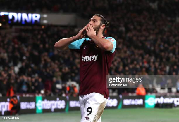 Andy Carroll of West Ham United celebrates after scoring his sides first goal during the Premier League match between West Ham United and West...