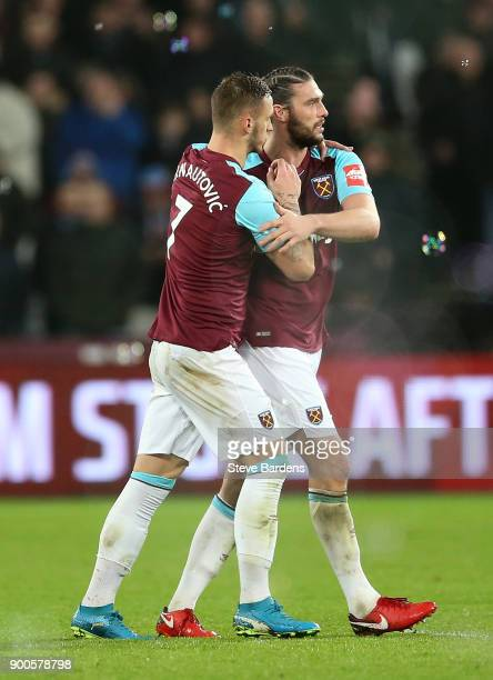 Andy Carroll of West Ham United celebrates after scoring his sides second goal with Marko Arnautovic of West Ham United during the Premier League...