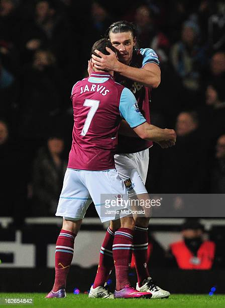 Andy Carroll of West Ham United celebrates his penalty with Matt Jarvis during the Barclays Premier League match between West Ham United and...