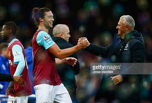Andy Carroll of West Ham United celebrates his team's 21 win with First Team Head of Performance Miljenko Rak after the Barclays Premier League match...