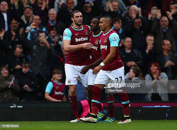 Andy Carroll of West Ham United celebrates his team's third and hat trick goal with his team mates during the Barclays Premier League match between...