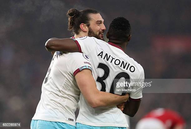 Andy Carroll of West Ham United celebrates scoring his sides first goal with Michail Antonio of West Ham United during the Premier League match...