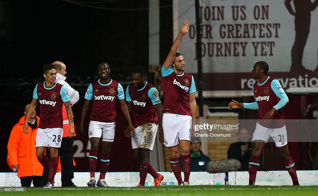 Andy Carroll of West Ham United (2R) celebrates scoring his side's second goal during the Barclays Premier League match between West Ham United and Southampton at the Boleyn Ground on December 28, 2015 in London, England.