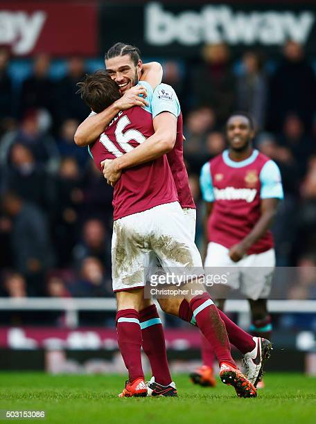 Andy Carroll of West Ham United celebrates scoring his team's second goal with his team mate Mark Noble during the Barclays Premier League match...