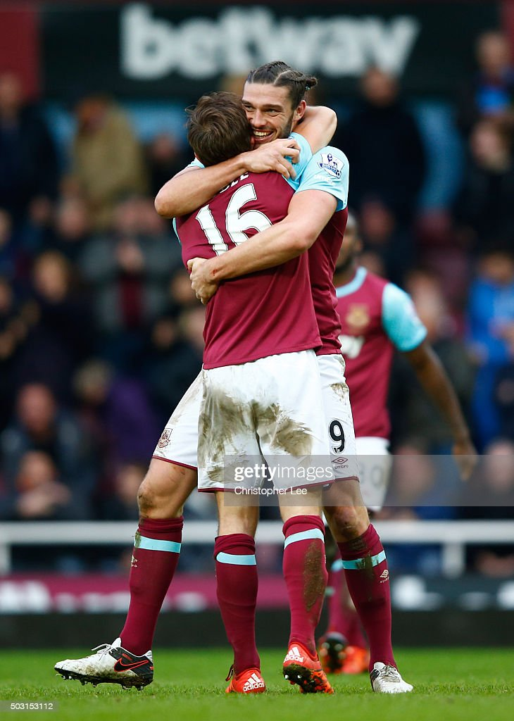 Andy Carroll (R) of West Ham United celebrates scoring his team's second goal with his team mate Mark Noble (L) during the Barclays Premier League match between West Ham United and Liverpool at Boleyn Ground on January 2, 2016 in London, England.