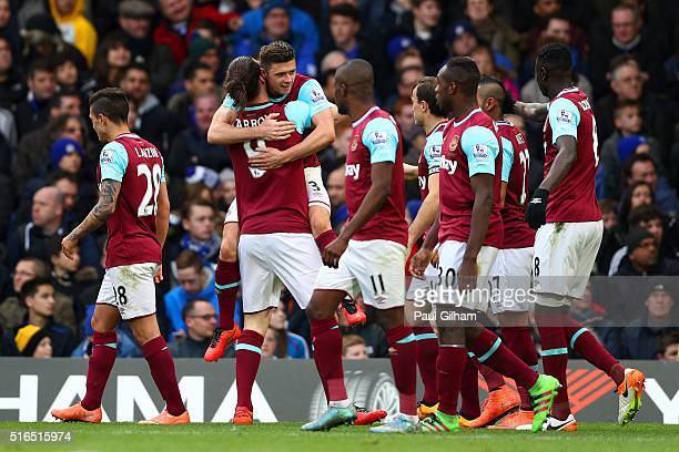 Andy Carroll of West Ham United celebrates scoring his team's second goal with his team mates during the Barclays Premier League match between...
