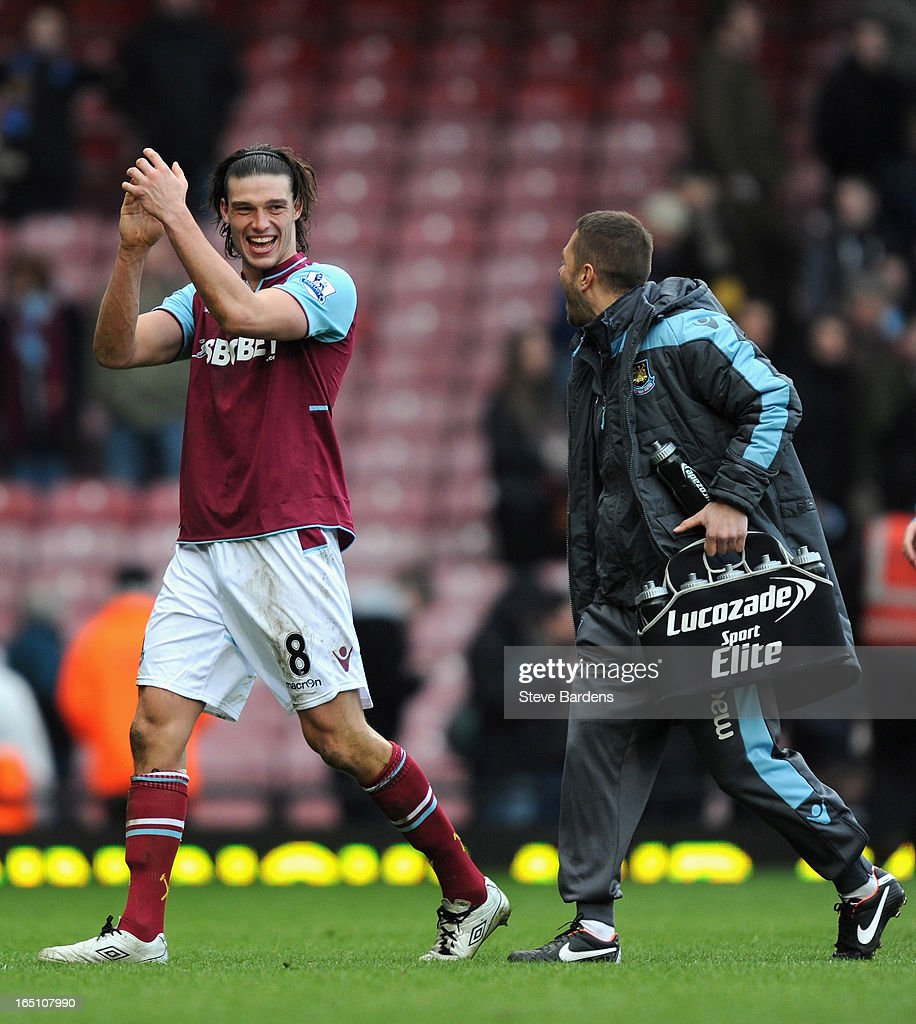 Andy Carroll of West Ham United celebrates victory and scoring two goal after the Barclays Premier League match between West Ham United and West Bromwich Albion at the Boleyn Ground on March 30, 2013 in London, England.