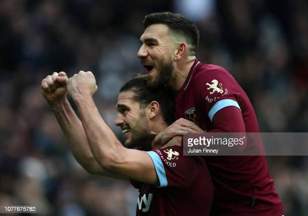 Andy Carroll of West Ham United celebrates with Robert Snodgrass after scoring his team's second goal during the FA Cup Third Round match between...