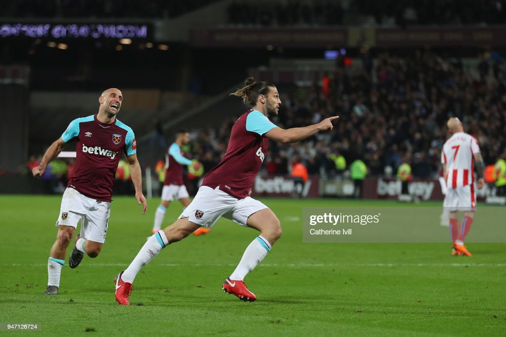 Andy Carroll of West Ham United celebrates with teammate Pablo Zabaleta of West Ham United after scoring his sides first goal during the Premier League match between West Ham United and Stoke City at London Stadium on April 16, 2018 in London, England.