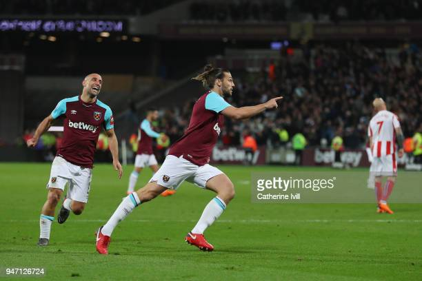 Andy Carroll of West Ham United celebrates with teammate Pablo Zabaleta of West Ham United after scoring his sides first goal during the Premier...