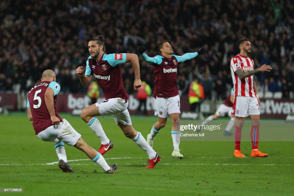 Andy Carroll of West Ham United celebrates with teammates Javier Hernandez of West Ham United and Pablo Zabaleta of West Ham United after scoring his sides first goal during the Premier League match between West Ham United and Stoke City at London Stadium on April 16, 2018 in London, England.