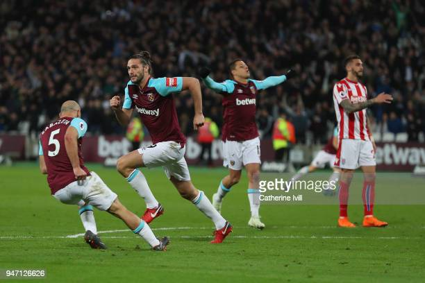 Andy Carroll of West Ham United celebrates with teammates Javier Hernandez of West Ham United and Pablo Zabaleta of West Ham United after scoring his...