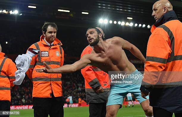 Andy Carroll of West Ham United gives his shirt away at the end of the Premier League match between Liverpool and West Ham United at Anfield on...