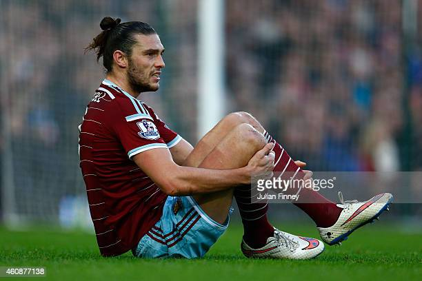 Andy Carroll of West Ham United holds his legs after a tackle during the Barclays Premier League match between West Ham United and Arsenal at Boleyn...