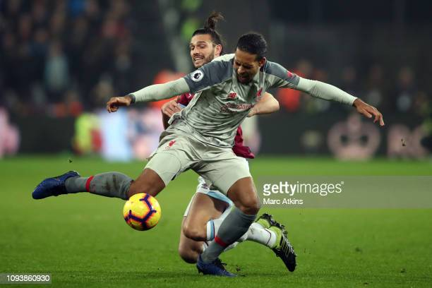 Andy Carroll of West Ham United in action with Virgil van Dijk of Liverpool during the Premier League match between West Ham United and Liverpool FC...
