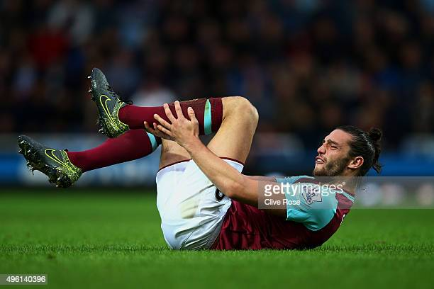 Andy Carroll of West Ham United lies injured during the Barclays Premier League match between West Ham United and Everton at Boleyn Ground on...