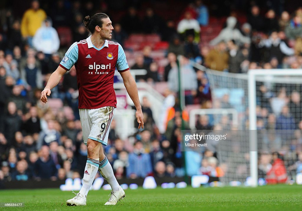 Andy Carroll of West Ham United looks on as he is sent off after a clash with Chico Flores of Swansea City (not pictured) during the Barclays Premier League match between West Ham United and Swansea City at Boleyn Ground on February 1, 2014 in London, England.