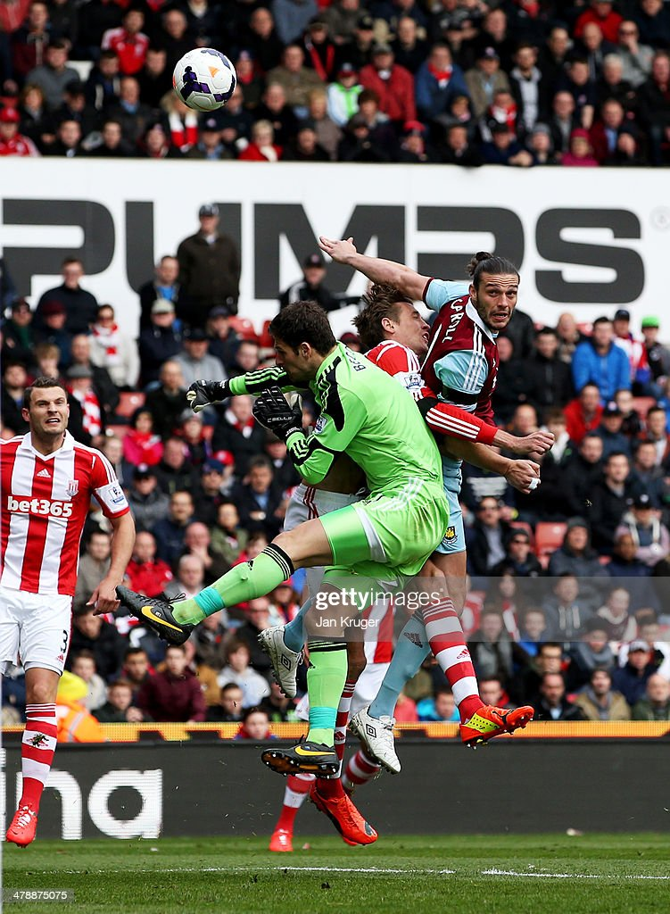 Andy Carroll of West Ham United outjumps Asmir Begovic and Peter Crouch of Stoke City to score their first goal with a header during the Barclays Premier League match between Stoke City and West Ham United at Britannia Stadium on March 15, 2014 in Stoke on Trent, England.