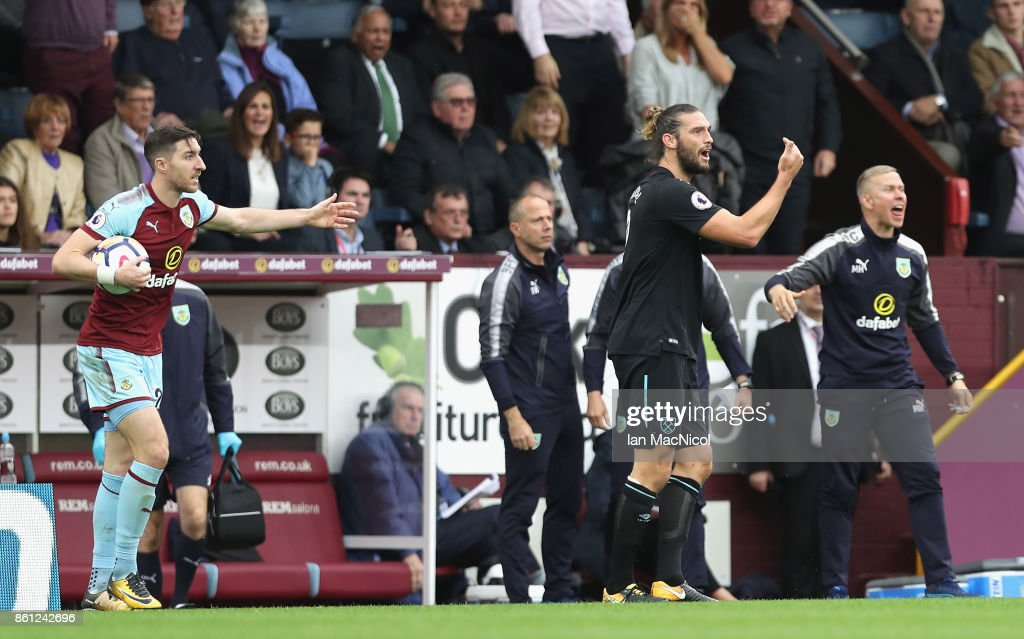 Andy Carroll of West Ham United reacts to being sent off during the Premier League match between Burnley and West Ham United at Turf Moor on October 14, 2017 in Burnley, England.