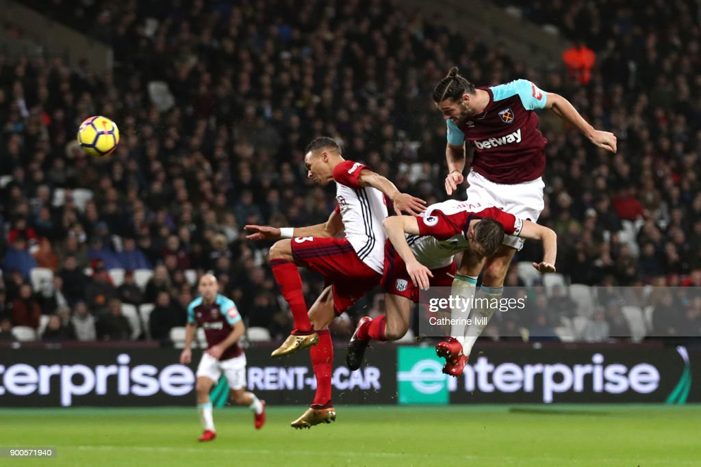 Andy Carroll of West Ham United scores his sides first goal during the Premier League match between West Ham United and West Bromwich Albion at London Stadium on January 2, 2018 in London, England.