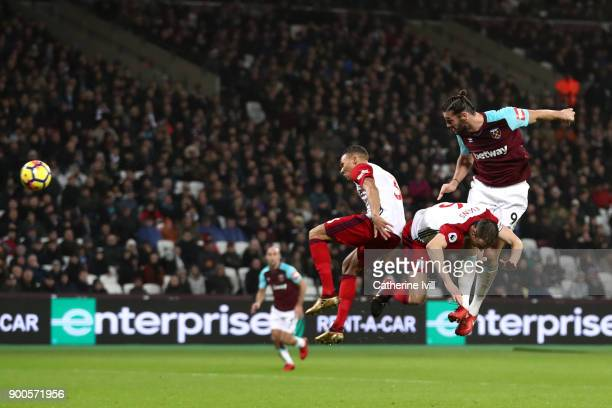 Andy Carroll of West Ham United scores his sides first goal during the Premier League match between West Ham United and West Bromwich Albion at...