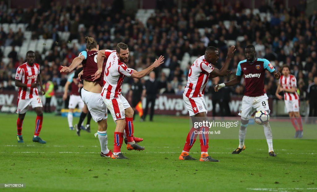 Andy Carroll of West Ham United scores his sides first goal during the Premier League match between West Ham United and Stoke City at London Stadium on April 16, 2018 in London, England.