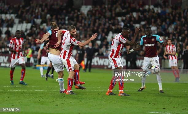 Andy Carroll of West Ham United scores his sides first goal during the Premier League match between West Ham United and Stoke City at London Stadium...