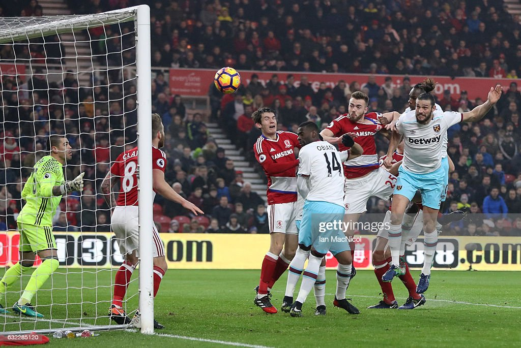 Andy Carroll of West Ham United (R) scores his sides first goal with a header during the Premier League match between Middlesbrough and West Ham United at the Riverside Stadium on January 21, 2017 in Middlesbrough, England.