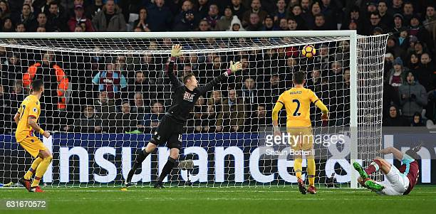 Andy Carroll of West Ham United scores his sides second goal during the Premier League match between West Ham United and Crystal Palace at London...