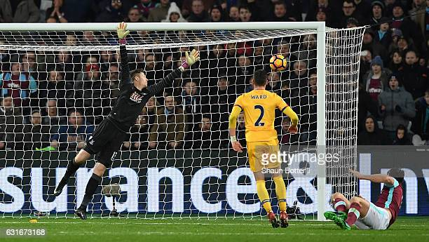 Andy Carroll of West Ham United scores his sides third goal past Wayne Hennessey of Crystal Palace during the Premier League match between West Ham...
