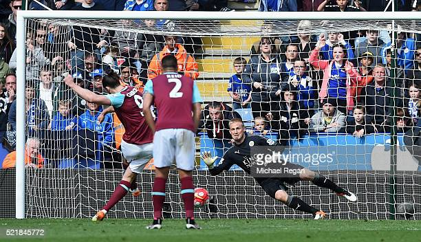 Andy Carroll of West Ham United scores his team's first goal from the penalty spot during the Barclays Premier League match between Leicester City...