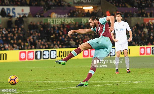 Andy Carroll of West Ham United scores his team's fourth goal during the Premier League match between Swansea City and West Ham United at Liberty...
